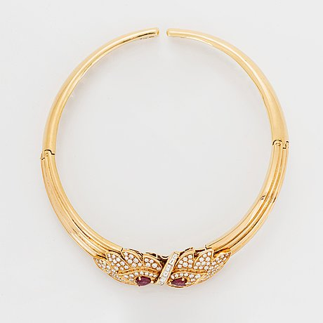 A necklace and a braclet in 18k gold set with faceted rubies.
