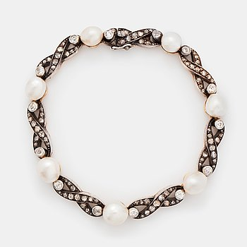 408. A bracelet in 18K gold and silver set with pearls and old- and rose-cut diamonds.