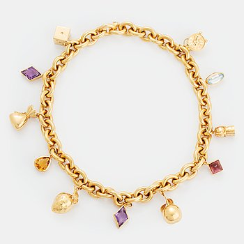 An 18k gold charm necklace.