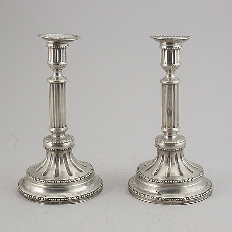 A pair of gustavian pewter candlesticks by peter gillman, stockholm 1794.