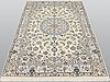 A rug, nain part silk so called 9 laa, ca 242 x 155 cm.