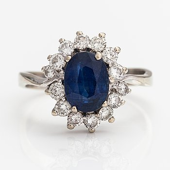 A 18K white gold ring with a sapphire ca. 2.20 ct and diamonds ca. 0.70 ct in total. Finnish import marks 1991.