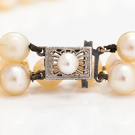 A 2-strand pearl collier with cultured pearls and a 14k white gold clasp.