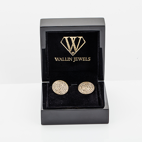 18k gold and black diamond cufflinks.