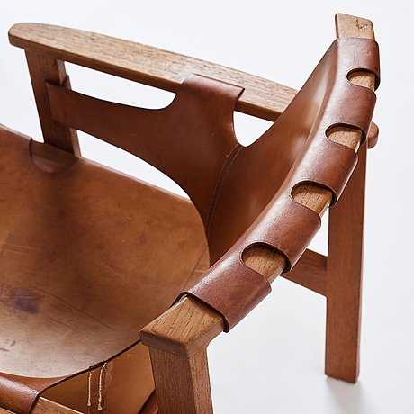 """Carl-axel acking, a """"trienna"""" oak and natural leather easy chair, for nordiska kompaniet, sweden 1960's."""