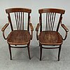 A pair if armchairs from the first half of the 20th century.