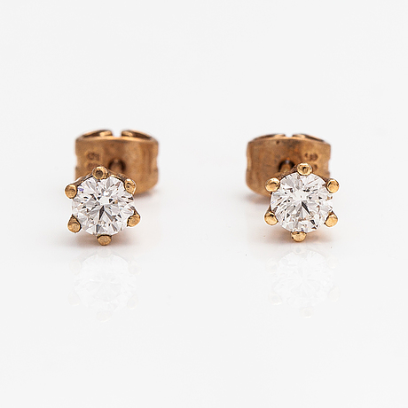 A pair of 14k gold earrings with diamonds ca. 0.50 ct int total.