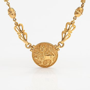"An 18K gold necklace ""Sun lion"". Kalevala koru, Helsinki 1998."