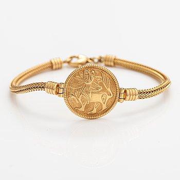 """An 18K gold bracelet """"Sun lion"""". Kalevala koru, Helsinki 1999."""