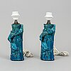 A pair of chinese blue glazed porcelain table lamps/vases, early 20th century.