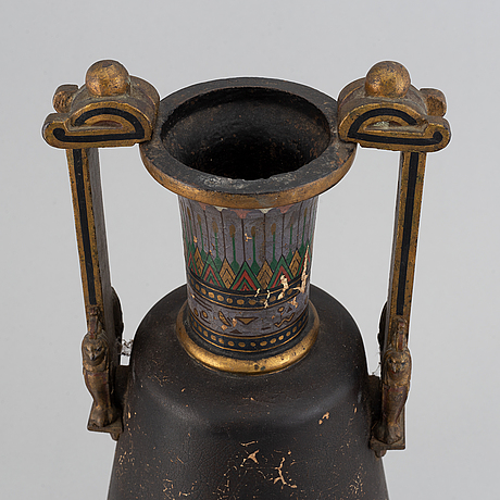 A late 19th century painted cast iron vase.