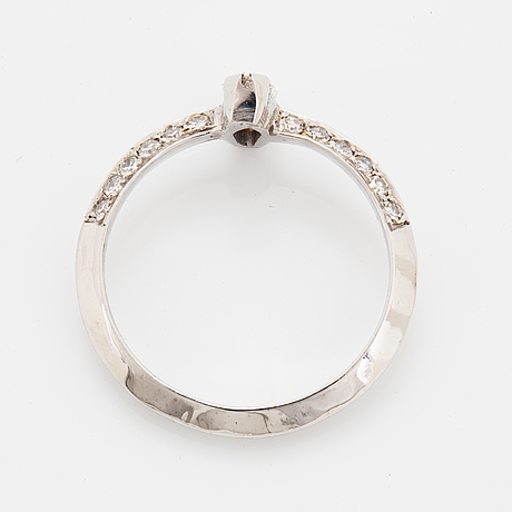 Marquise-cut diamond and eight-cut diamond ring.