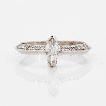 Marquise-cut diamond and eight-cut diamond ring.