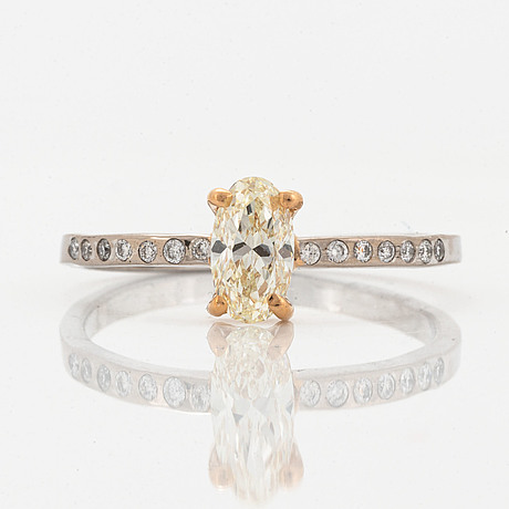 Oval diamond and brilliant-cut diamond ring.