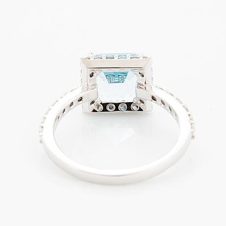 Blue topaz and brilliant-cut diamond ring.