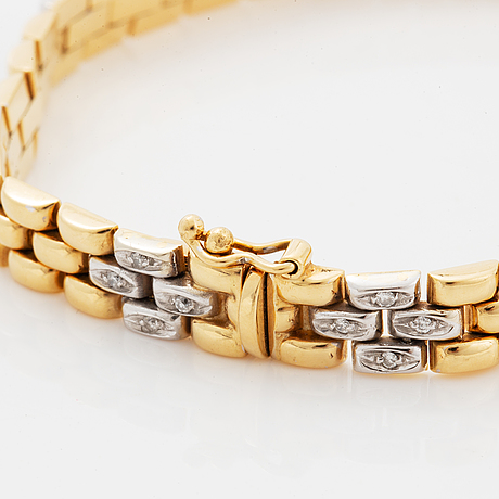 18k gold and brilliant-cut diamond bracelet.
