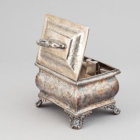 A richly decorated sugar box,maker'smark christian hammer, stockholm, 1847.