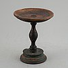 A 19th century wooden butter stand.