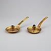 Four 18th century brass night light holders.