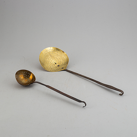 A sieve and ladle, brass, 18th century.
