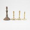 Four 18th century brass candlesticks.