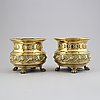 A pair of 19th century brass urns.