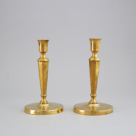 A pair of late 18th century directoire  bronze candlesticks.