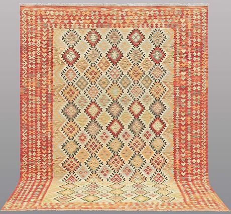 A carpet, kilim, ca 346 x 259 cm.