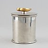 Estrid ericson, a pewter and brass jar with cover by svenskt tenn, stockholm 1993.
