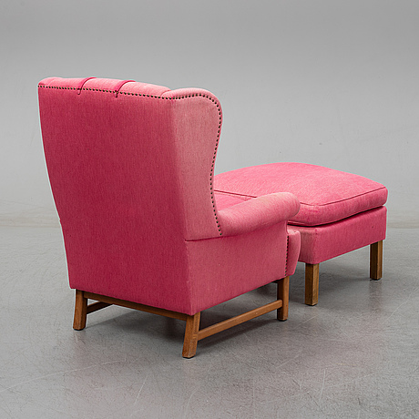 An 'oxford' model no 3543 easy chair with stool by ragnar helsén for firma svenskt tenn.