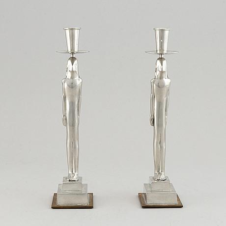Edvin öhrström, a pair of candlesticks by firma svenskt tenn, stockholm 1994.