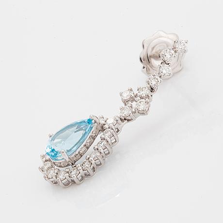 Topaz and brilliant-cut diamond earrings.