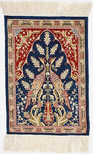 A rug, silk hereke, ca 58 x 40 cm.