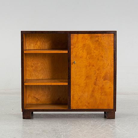 A birch veneered book shelf.