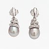 A pair of 14k white gold earrings with cultured pearls and diamonds ca. 0.06 ct in total. caratia, helsinki 2001.