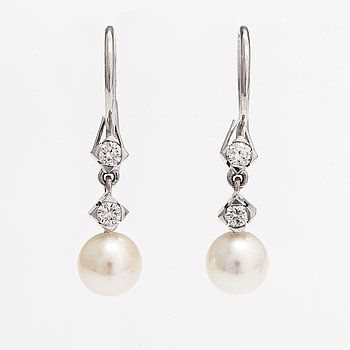 A pair of 18K white gold earrings with cutured pearls and diamonds ca. 0.24 ct in total. Westerback, Helsinki.