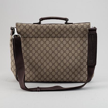 Gucci, a messenger bag.