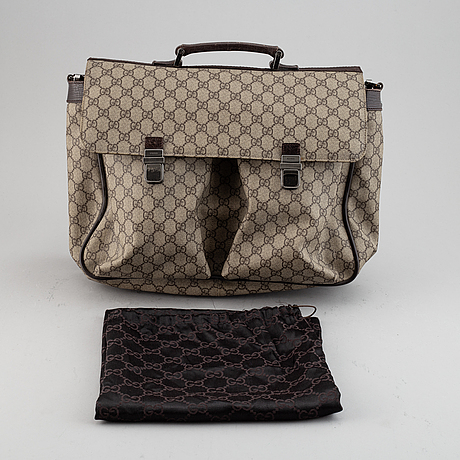 Gucci, a messenger bag.