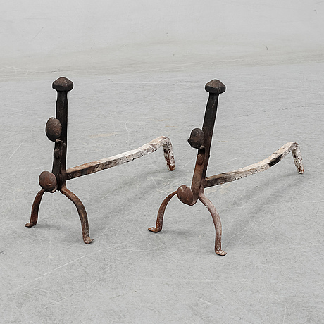 A pair of cast iron fire dogs, 19th century.