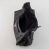 Yves saint laurent, a black leather bag.