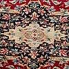 A carpet, a semi-antique/old kerman, ca 413,5-418 x 295-299 cm.