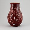A red glazed chinese vase, 20th century.