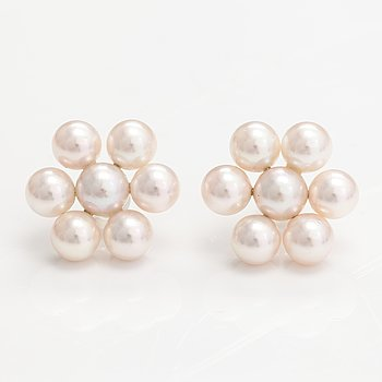 A pair of earrings with cultured salt water pearls and 18K white gold.