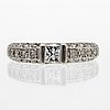 Ring 18k whitegold 1 princess-cut and brilliant cut diamonds, 0,31 ct and 0,50 ct  inscribed respectively, size 50.