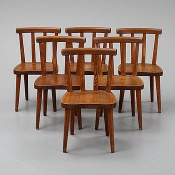 "Axel Einar Hjorth, a set of six stained pine ""Utö"" chairs, Nordiska Kompaniet, Sweden."