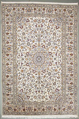 A carpet from kashan, around 349 x 240 cm.