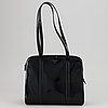 Prada, a patent leather bag.