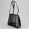 Prada, a patent leather bag.