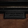 Bottega veneta, a black leather bag.