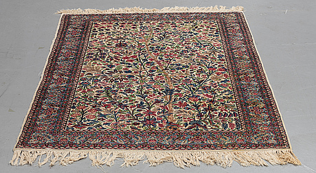 A rug, semi-antique kerman, ca 226 x 142 cm.